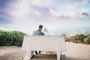 bride and groom on bench - San Diego Wedding photographer